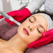 image of woman receiving microneedling